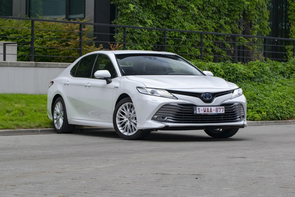 Berlin, Germany - 10 July, 2019: Toyota Camry Hybrid on the street. The Camry is one of the most popular sedan vehicles in the world.