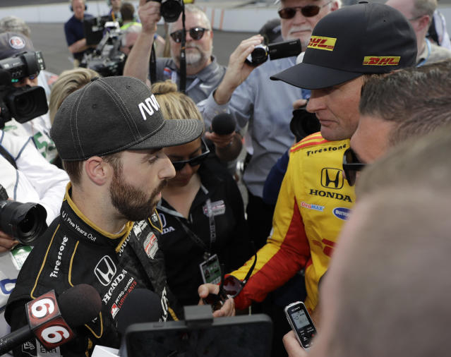 Ryan Hunter-Reay, right, talks with James Hinchcliffe, of Canada, after Hinchcliffe did not qualify for the IndyCar Indianapolis 500 auto race at Indianapolis Motor Speedway in Indianapolis, Saturday, May 19, 2018. (AP Photo/Darron Cummings)