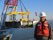 Philip He is seen working as an engineer for the California state transportation agency on a Bay Bridge renovation project in a family handout picture taken in October 2011 and provided to Reuters in December 2013. REUTERS/Family Photo/Handout