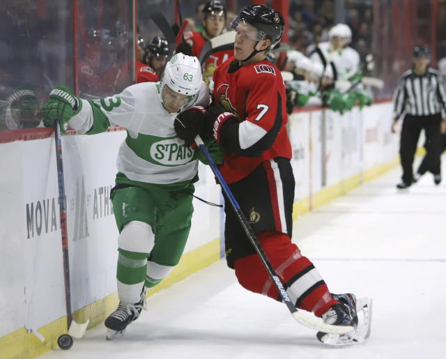 Ottawa Senators left wing Brady Tkachuk (7) checks Toronto Maple Leafs left wing Tyler Ennis (63) during the first period of an NHL hockey game in Ottawa, Saturday, March 16, 2019. (Fred Chartrand/The Canadian Press via AP)
