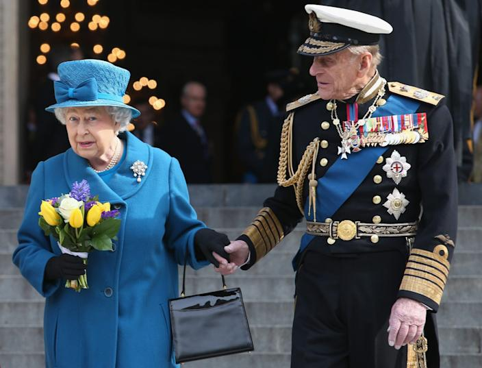 queen and prince philip holding hands