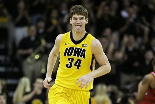 Iowa center Adam Woodbury reacts after making a basket during the first half of an NCAA college basketball game against Nebraska, Saturday, March 9, 2013, in Iowa City, Iowa. (AP Photo/Charlie Neibergall)