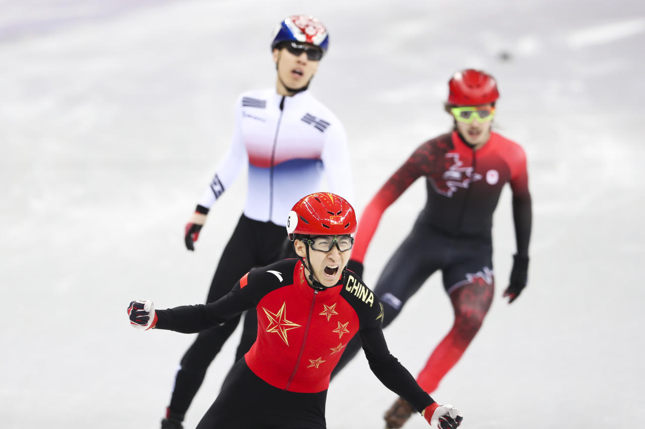 <p>China's Wu Dajing celebrates after winning gold in the Men's 500m Short Track Speed Skating Final A on day 13 of the PyeongChang 2018 Winter Olympic Games on February 22, 2018.<br /> (Photo by VCG/VCG via Getty Images) </p>