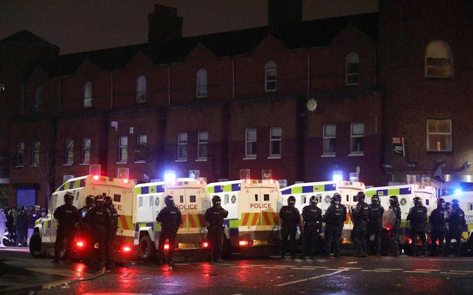 Police moved in to separate nationalists and loyalists on Lanark Way - AP