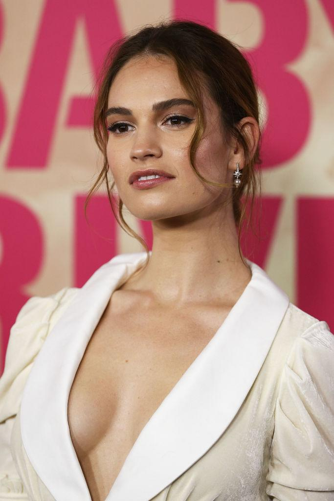 Lily James smooches married co-star Dominic West