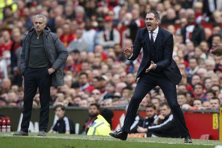Britain Football Soccer - Manchester United v Swansea City - Premier League - Old Trafford - 30/4/17 Manchester United manager Jose Mourinho and Swansea City manager Paul Clement Reuters / Andrew Yates Livepic