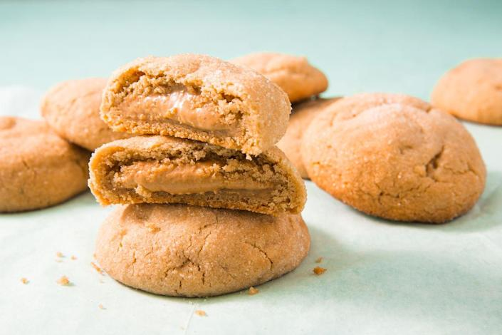 """<p>To prevent a pb explosion when baking, first mix peanut butter with powdered sugar, roll mixture into balls, and freeze. <br></p><p>Get the recipe from <a href=""""https://www.delish.com/cooking/recipe-ideas/recipes/a51853/peanut-butter-stuffed-cookies-recipe/"""" rel=""""nofollow noopener"""" target=""""_blank"""" data-ylk=""""slk:Delish"""" class=""""link rapid-noclick-resp"""">Delish</a>.</p>"""