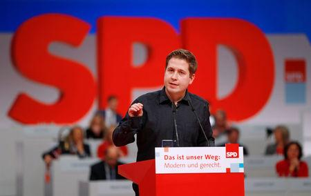 FILE PHOTO: Kevin Kuehnert, the head of the SPD's youth wing, speaks during an SPD party convention in Berlin, Germany, December 7, 2017. REUTERS/Fabrizio Bensch/File Photo