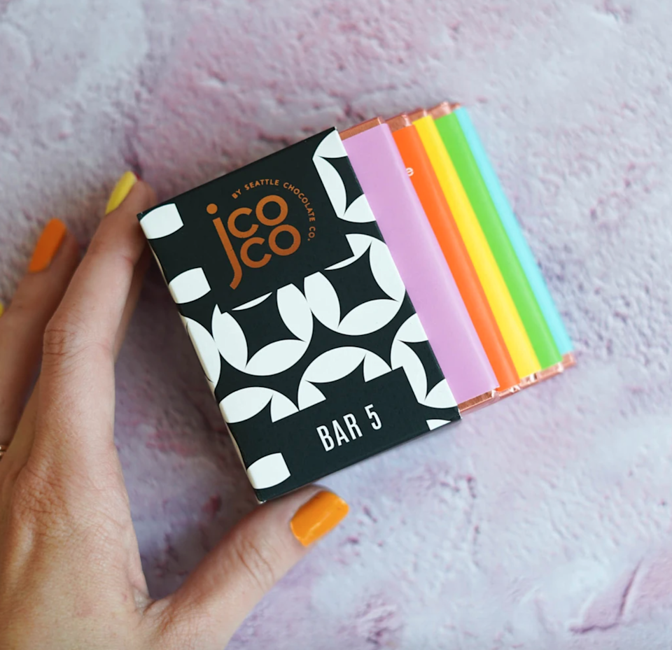 """<h2>jcoco Bar 5 Milk + White Sampler</h2><br><strong>Best For: Mom<br>Budget: $15</strong><br>When CEO Jean Thompson founded jcoco<em>,</em> the ultra-premium sister brand to Seattle Chocolate, her mission was to turn an everyday indulgence into an opportunity to make a difference. Send your mom of the brand's signature minibars for a sweet gift that gives back: Since its 2012 launch, jcoco has donated more than 3.5 million servings to organizations working to combat hunger.<br><br><em>Shop <a href=""""https://www.seattlechocolate.com/pages/jcocochocolate"""" rel=""""nofollow noopener"""" target=""""_blank"""" data-ylk=""""slk:Seattle Chocolate Co."""" class=""""link rapid-noclick-resp""""><strong>Seattle Chocolate Co.</strong></a> </em><br><br><strong>Seattle Chocolate</strong> Bar 5 Milk + White, $, available at <a href=""""https://go.skimresources.com/?id=30283X879131&url=https%3A%2F%2Fwww.seattlechocolate.com%2Fcollections%2Fjcoco-gifts%2Fproducts%2Fbright-bar-5"""" rel=""""nofollow noopener"""" target=""""_blank"""" data-ylk=""""slk:Seattle Chocolate"""" class=""""link rapid-noclick-resp"""">Seattle Chocolate</a>"""