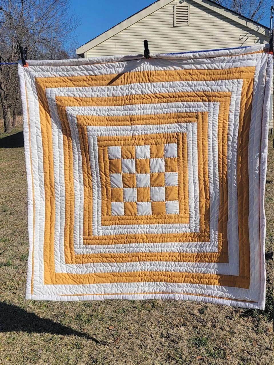 """<h2>Quilts by Caster Handmade Quilt<br></h2><br>She taught you how to sew — or at least tried to — and collects needlepoint canvases that she finds at antique shops and estate sales. As a lover of all things handmade and a textile connoisseur, she'd definitely cherish a handmade quilt from a member of the legendary collective of Gee's Bend, Alabama. While some of the handmade creations are pricey, each one is a living work of art — something she understands better than anyone.<br><br><em>Shop <strong><a href=""""https://www.etsy.com/shop/QuiltsByCaster"""" rel=""""nofollow noopener"""" target=""""_blank"""" data-ylk=""""slk:Quilts by Caster"""" class=""""link rapid-noclick-resp"""">Quilts by Caster</a></strong> on Etsy</em><br><br><strong>Quilts by Caster</strong> Gold and White Housetop Quilt, $, available at <a href=""""https://go.skimresources.com/?id=30283X879131&url=https%3A%2F%2Fwww.etsy.com%2Flisting%2F967533501%2Fhandsewn-quilt-cotton-wallhanger"""" rel=""""nofollow noopener"""" target=""""_blank"""" data-ylk=""""slk:Etsy"""" class=""""link rapid-noclick-resp"""">Etsy</a>"""