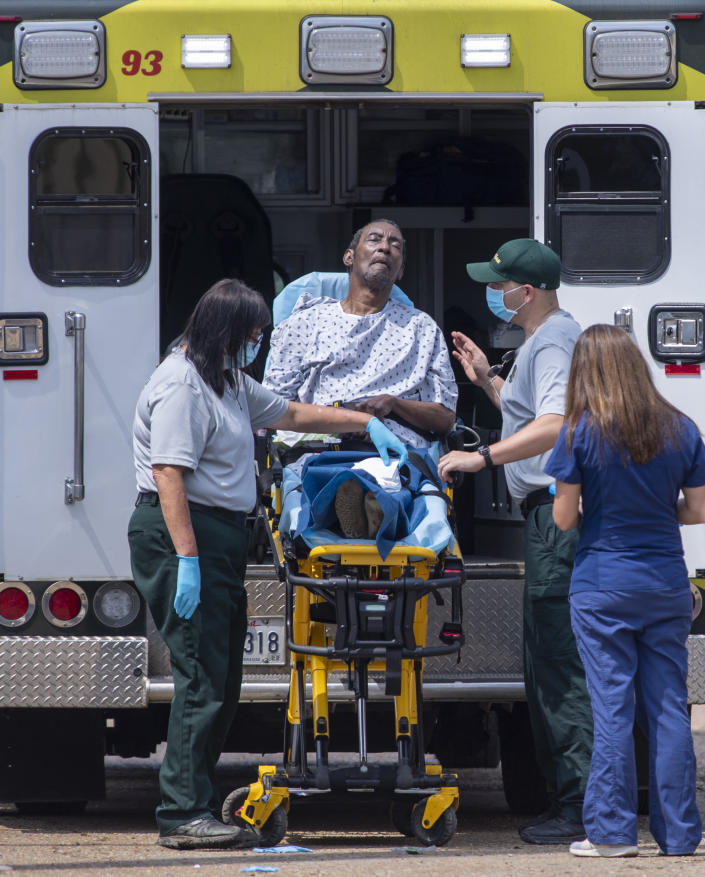 Emergency personnel evacuate people at a mass shelter Thursday, Sept. 2, 2021 in Independence, La. Multiple nursing home residents died after Hurricane Ida, but full details of their deaths are unknown because state health inspectors said Thursday that they were turned away from examining conditions at the facility to which they had been evacuated. (Chris Granger/The Times-Picayune/The New Orleans Advocate via AP)