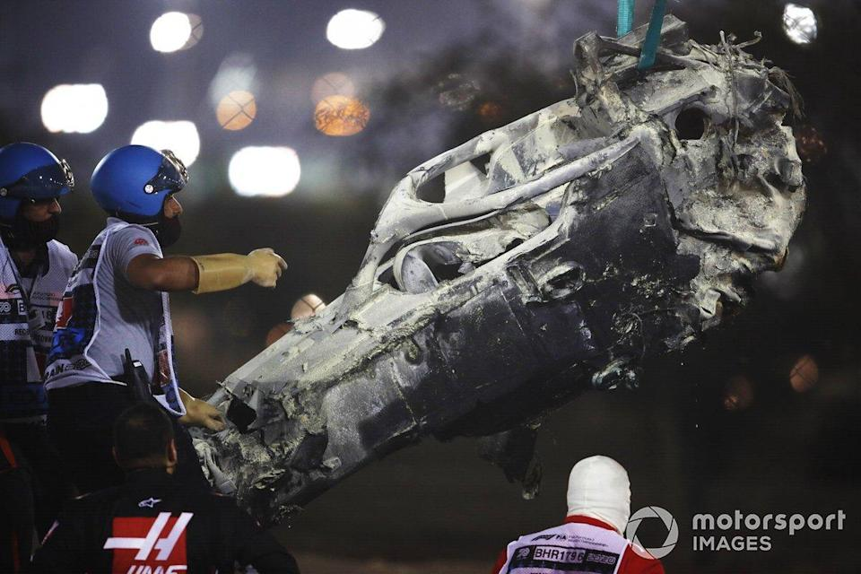 "Marshals remove the wreckage after a huge crash for Romain Grosjean, Haas VF-20, on the opening lap<span class=""copyright"">Zak Mauger / Motorsport Images</span>"