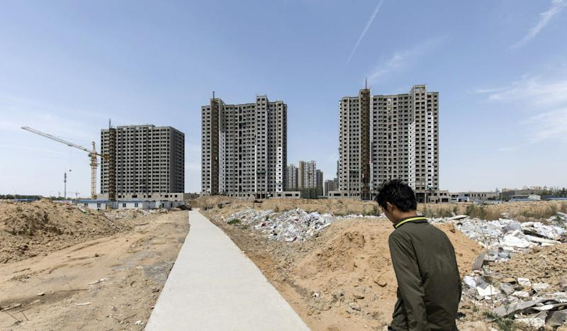 China's land auction premiums drop to lowest levels in over three years as price curbs show effect