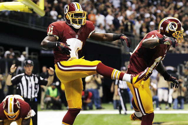 Washington Redskins wide receiver Aldrick Robinson (11) celebrates his touchdown with wide receiver Josh Morgan, right, in the first half of an NFL football game against the New Orleans Saints in New Orleans, Sunday, Sept. 9, 2012. The Redskins won 40-32. (AP Photo/Bill Haber)