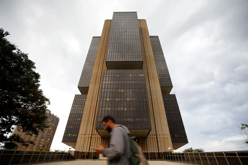 FILE PHOTO: A man walks in front the Central bank headquarters building in Brasilia