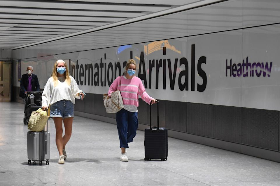 Passengers wearing face masks as they arrive at Heathrow Airport after a flight from Dubrovnik, Croatia, landed. The UK government announced that from 4am on Saturday, travellers to the UK from Croatia, Austria and Trinidad and Tobago will have to quarantine for 14 days on arrival.