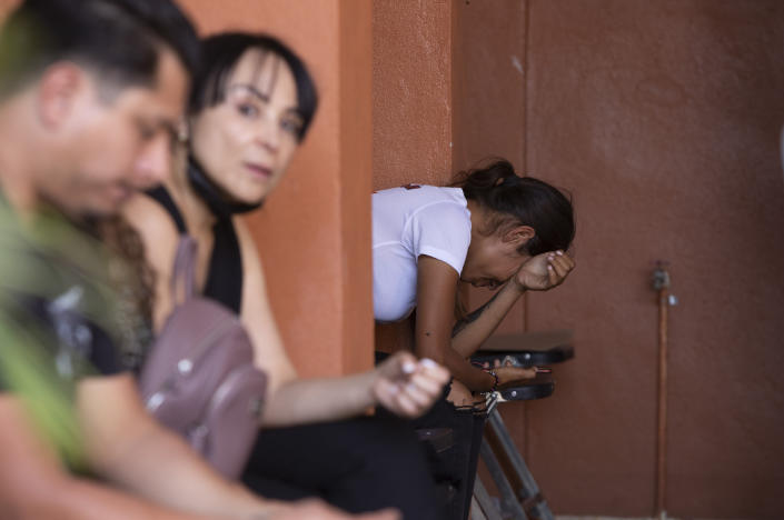 Friends mourn during the wake of mayoral candidate Alma Barragan in Moroleon, Mexico, Wednesday, May 26, 2021. Barragan was killed Tuesday while campaigning for the mayorship of the city of Moroleon, in violence-plagued Guanajuato state. (AP Photo/Armando Solis)