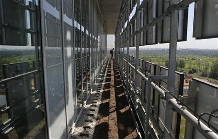 A man stands on a balcony of the Skolkovo Hypercube at the Skolkovo Innovation Center on the outskirts of Moscow