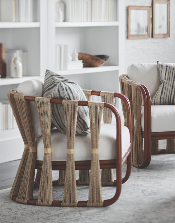 """<p>The Strings Attached Lounge Chair delivers polish, sophistication, and comfort with a solid rattan frame in natural finish, plus deep customizable cushions surrounded by a visually witty element: spindles of bundled natural abaca rope. </p><p>Danielle's A-List Anecdote:<em>""""I've always been a fan of the Strings Attached Lounge Chair. My inner hippie gets really happy with this arm chair. It's the perfect item to pair with a fun, fresh fabric and can work as a solo chair in a bedroom or with a buddy in a great open, airy living space.""""</em></p><p><u>Learn More at <a href=""""https://www.palecek.com/palecek/"""" rel=""""nofollow noopener"""" target=""""_blank"""" data-ylk=""""slk:palecek.com"""" class=""""link rapid-noclick-resp"""">palecek.com</a>!</u></p>"""