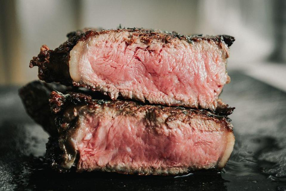 """<p>Red meat certainly isn't perfect, but it also isn't something you need to avoid completely. """"Red meat has often been associated with coronary artery disease risk, but <a href=""""https://www.ncbi.nlm.nih.gov/pmc/articles/PMC3483430/"""" rel=""""nofollow noopener"""" target=""""_blank"""" data-ylk=""""slk:a study in 2012"""" class=""""link rapid-noclick-resp"""">a study in 2012</a> indicated that the risk varies based on processing, with a lot of those differences based on the amount of sodium in the processed meat (hot dogs, bacon, cold cuts),"""" Dr. Alex Schwartz, nutrition scientist and curriculum designer at <a href=""""https://www.precisionnutrition.com/"""" rel=""""nofollow noopener"""" target=""""_blank"""" data-ylk=""""slk:Precision Nutrition"""" class=""""link rapid-noclick-resp"""">Precision Nutrition</a>, tells us. """"Red meat is a source of protein and high in iron and vitamin B12."""" Basically, just be picky and choosy about your red meat—opt for a piece of steak over a pile of bacon, for example.</p>"""