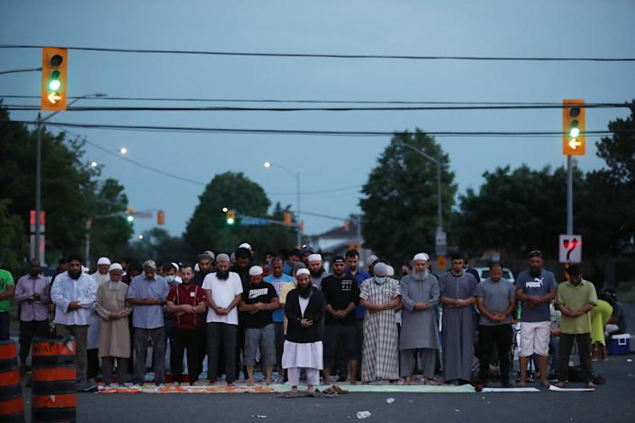 MISSISSAUGA, ON- JUNE 22 - Prayers are held in the intersection. After a rally and a march, protesters continue to occupy the intersection of Goreway and Morning Star, as they hold vigil outside the Malton apartment building where 62-year-old Ejaz Choudry was fatally shot by Peel police officers Saturday after police responded to a call for a mental-health crisis. June 22, 2020. (Steve Russell/Toronto Star via Getty Images)