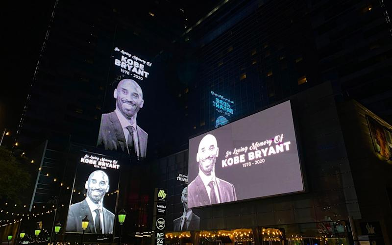 Buildings around the Los Angeles Lakers home arena pay tribute to Kobe Bryant - AFP