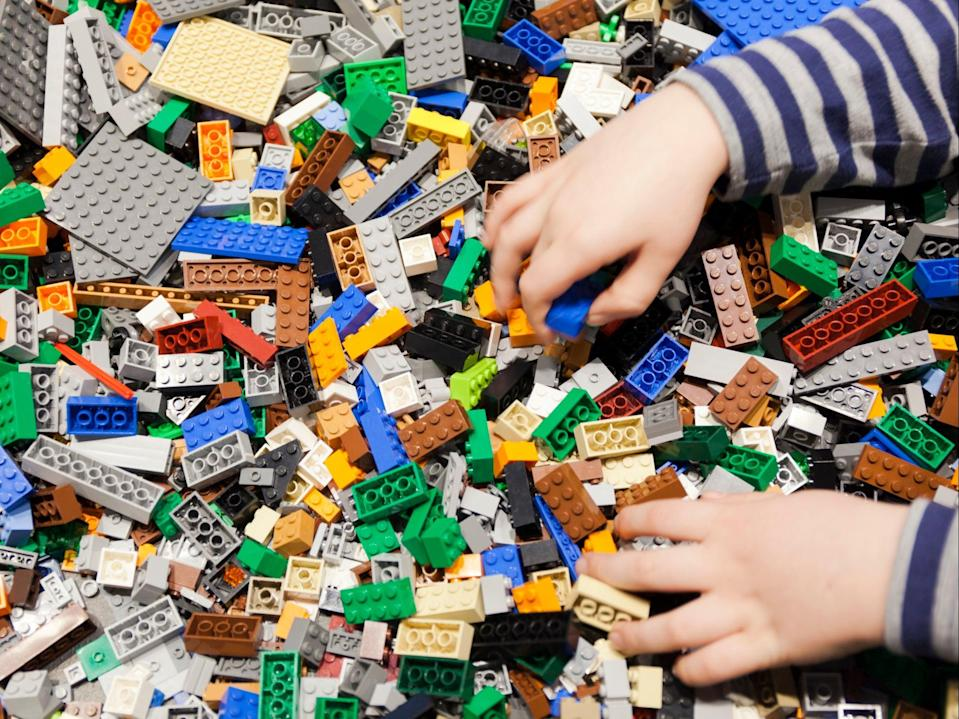 Lego manufactures around 100,000 tonnes of plastic blocks each year (Getty)