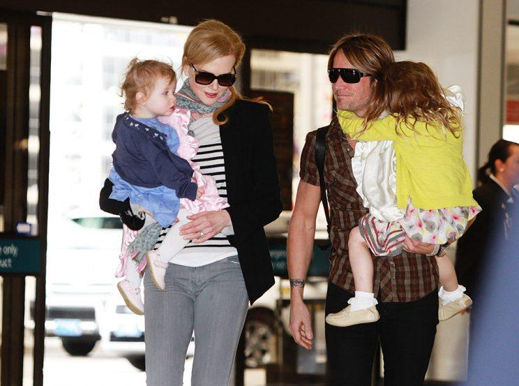 Editorial Use Only. Consent Required for Commercial Use and Book Publications Mandatory Credit: Photo by Craig Greenhill/Newspix/REX/Shutterstock (1757622a) Nicole Kidman with daughter Faith Urban and Keith Urban with Sunday Rose Urban Nicole Kidman and Keith Urban and children at Sydney International Airport, Sydney, Australia - 22 Jun 2012