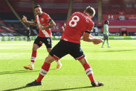 Southampton's James Ward-Prowse, right, celebrates with Southampton's Danny Ings after scoring his side's opening goal during an English Premier League soccer match between Southampton and Everton at the St. Mary's stadium in Southampton, England, Sunday Oct. 25, 2020. (Andy Rain/Pool via AP)