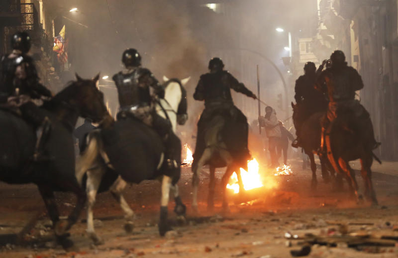 Mounted police advance on demonstrators protesting the president near the government palace in Quito, Ecuador, Thursday, Oct. 3, 2019. Ecuador's President Lenín Moreno has declared a state of emergency to confront street protests and a nationwide transport strike over his decision to end government fuel subsidies and relax labor protections. (AP Photo/Dolores Ochoa)