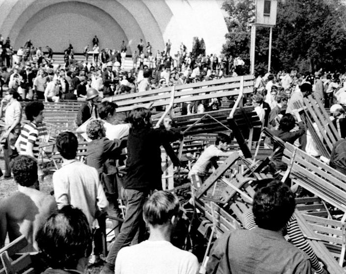 Long haired and bearded Hippies and Yippies use park benches at Grant Park's Band Shell to construct a barricade against Chicago police and National Guardsmen in Chicago on August 28, 1968. The confrontation left many injured and arrested. Grant Park is at the edge of downtown Chicago near the Conrad Hilton Hotel. The hotel is the headquarters for the Democratic National Convention now in session in Chicago. (AP Photo)