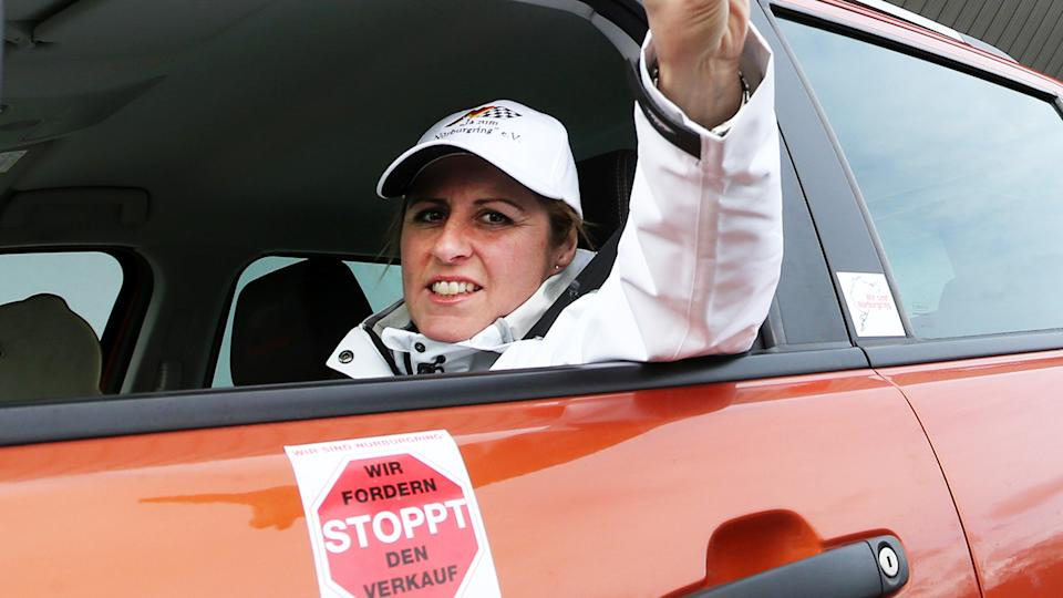 Sabine Schmitz, pictured here during a car parade at the Nuerburgring race track.