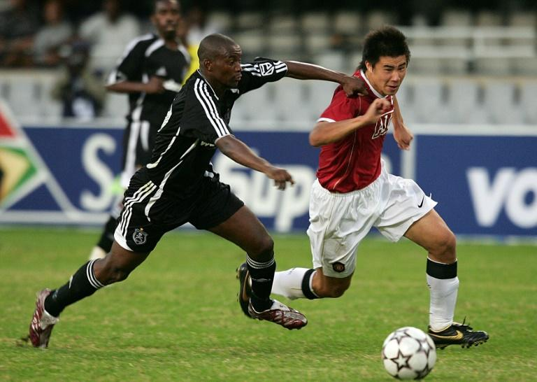 New Chippa United coach Lehlohonolo Seema (L) playing for Orlando Pirates against Manchester United in a tour match