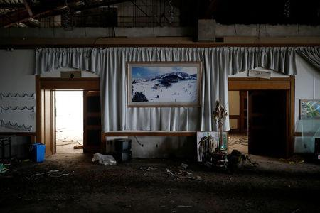 A poster of the snow-covered resort hangs on a wall at the abandoned Alps Ski Resort located near the demilitarised zone separating the two Koreas in Goseong, South Korea, January 17, 2018. REUTERS/Kim Hong-Ji