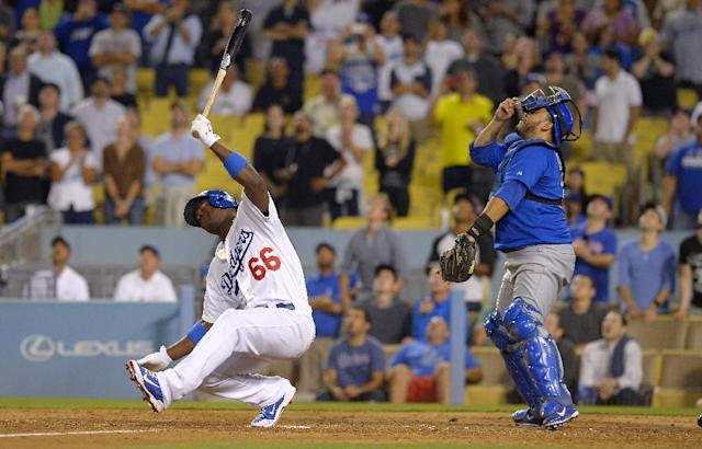 Los Angeles Dodgers' Yasiel Puig, left, reacts as he pops out to end the their baseball game as Chicago Cubs catcher Dioner Navarro looks on, Tuesday, Aug. 27, 2013, in Los Angeles. The Cubs won 3-2. (AP Photo/Mark J. Terrill)