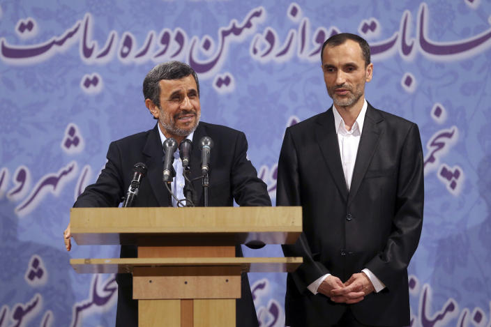 Former Iranian President Mahmoud Ahmadinejad, left, and his close ally Hamid Baghaei attend a press conference after registering his candidacy for the upcoming presidential election, at the election headquarters of the interior ministry, in Tehran, Iran, Wednesday, April 12, 2017. Ahmadinejad on Wednesday unexpectedly filed to run in the country's May presidential election, contradicting a recommendation from the supreme leader to stay out of the race. (AP Photo/Ebrahim Noroozi)