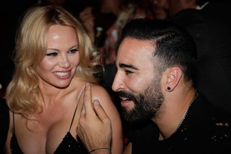 "US actress Pamela Anderson (L) and Marseille's French defender Adil Rami (R) attend the Premiere of the new show ""Bionic ShowGirl"" at the ""Crazy Horse"" cabaret on June 3, 2019 in Paris. (Photo by Geoffroy VAN DER HASSELT / AFP) (Photo credit should read GEOFFROY VAN DER HASSELT/AFP/Getty Images)"