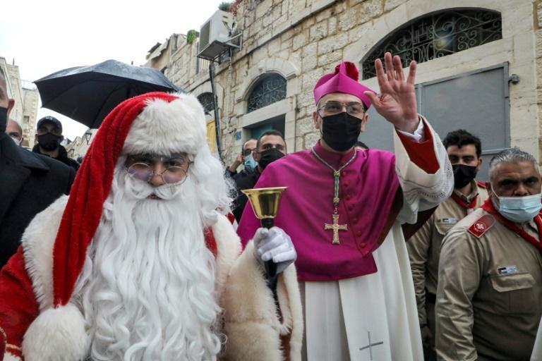 In Bethlehem, the Latin Patriarch of Jerusalem, Archbishop Pierbattista Pizzaballa, arrived to attend Christmas celebrations -- walking alongside a man dressed as Father Christmas, or Santa Claus