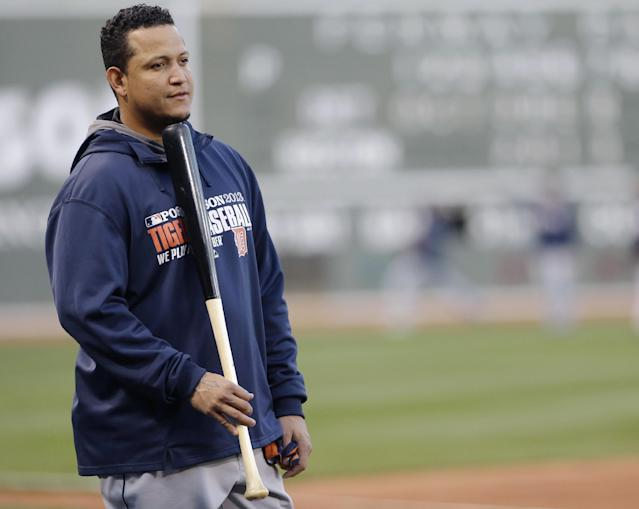 Detroit Tigers third baseman Miguel Cabrera waits to take the field before the baseball team's workout at Fenway Park in Boston, Friday, Oct. 11, 2013. The Tigers will face the Boston Red Sox in Game 1 of the American League championship series on Saturday. (AP Photo/Charlie Riedel)