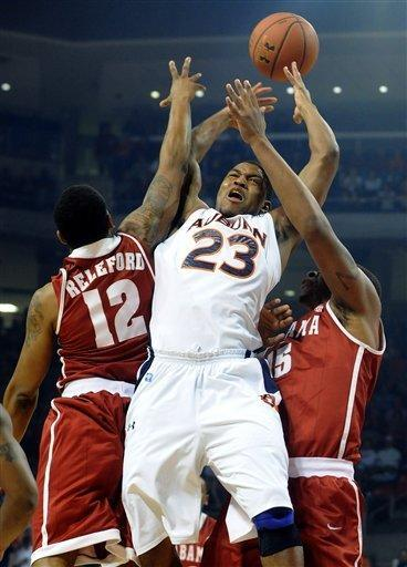 Auburn's Frankie Sullivan works against Alabama's Trevor Releford (12) and Nick Jacobs (15) for a rebound in the first half of an NCAA college basketball game in Auburn, Ala., Tuesday, Feb. 7, 2012. (AP Photo/The Birmingham News, Mark Almond) MAGS OUT