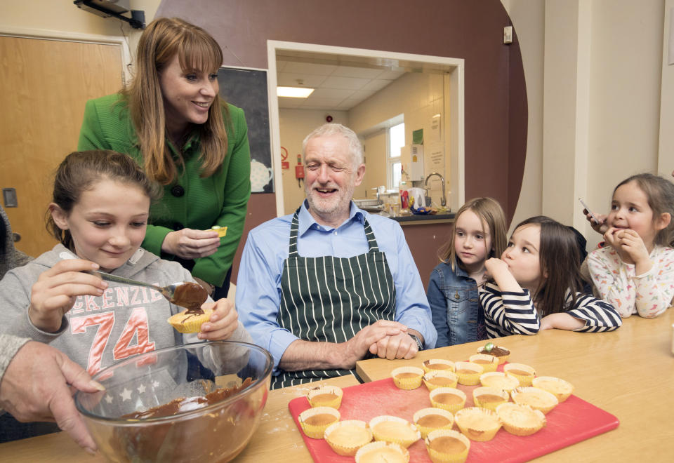 Labour leader Jeremy Corbyn and shadow education secretary Angela Rayner during a cooking lesson visit a children's holiday club at The Leyland Project in Leyland, Lancashire. (Photo by Danny Lawson/PA Images via Getty Images)