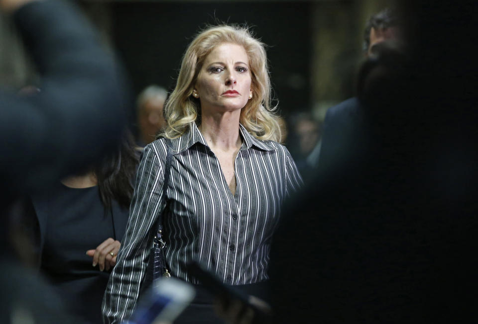 """FILE - In this Dec. 5, 2017, file photo, Summer Zervos leaves Manhattan Supreme Court at the conclusion of a hearing in New York. The former """"Apprentice"""" contestant is trying to get her defamation lawsuit against former President Donald Trump moving again now that he's no longer president. (AP Photo/Kathy Willens, File)"""