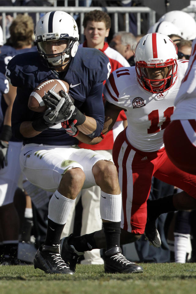 Penn State receiver Derek Moye, left, hauls in a pass from quarterback Matt McGloin in front of Nebraska cornerback Andrew Green (11) during the first quarter of an NCAA college football game in State College, Pa., Saturday, Nov. 12, 2011. (AP Photo/Gene J. Puskar)
