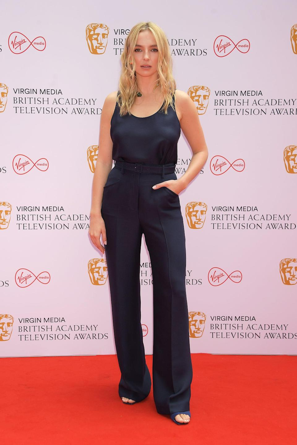 <p>Jodie Comer wore a muted navy Gabriela Hearst set with jewels by Gabriela Hearst and Tiffany &amp; Co.</p>