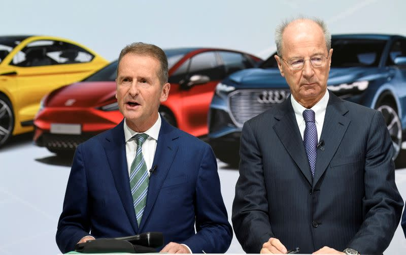 FILE PHOTO: Volkswagen CEO, Herbert Diess and chairman of the supervisory board Hans Dieter Poetsch, address the media after a supervisory board meeting at the Volkswagen plant in Wolfsburg
