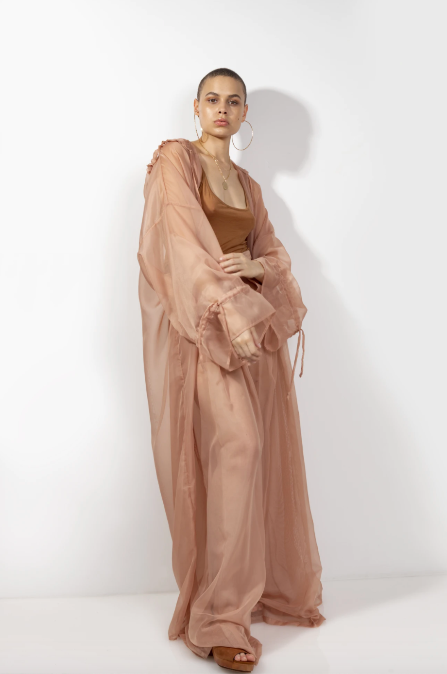 """<p><strong>Fe Noel</strong></p><p>fenoel.com</p><p><strong>$248.00</strong></p><p><a href=""""https://fenoel.com/collections/shop-all/products/a-lucid-blush-trench-hoody-lucid-blush-hoody-robe?variant=9225752444972"""" rel=""""nofollow noopener"""" target=""""_blank"""" data-ylk=""""slk:Shop Now"""" class=""""link rapid-noclick-resp"""">Shop Now</a></p><p>Here's a glam way to upgrade your outerwear game.</p>"""