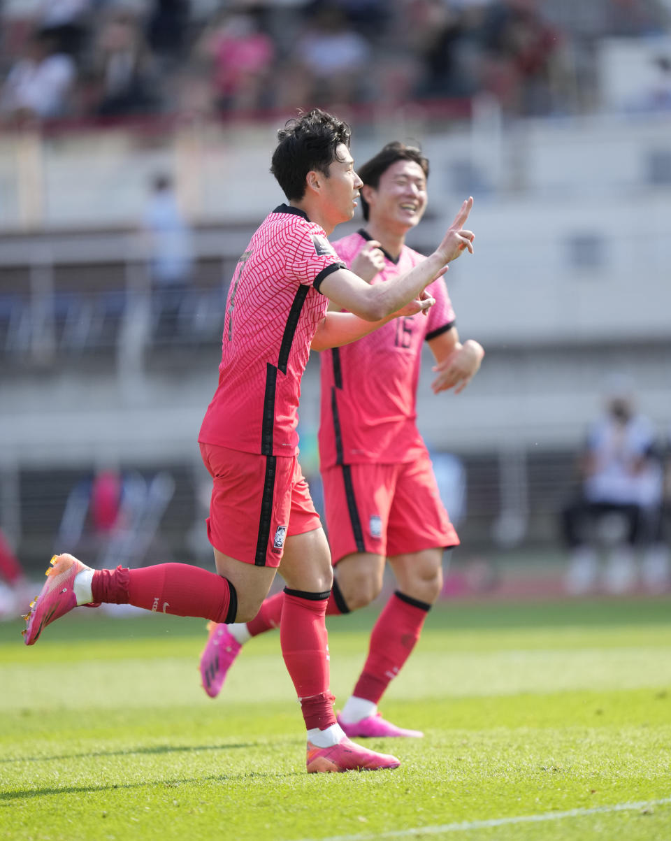South Korea's Son Heung-min, celebrates after scoring his side's second goal on a penalty kick against Lebanon during their Asian zone Group H qualifying soccer match for the FIFA World Cup Qatar 2022 at Goyang stadium in Goyang, South Korea, Sunday, June 13, 2021. (AP Photo/Lee Jin-man)