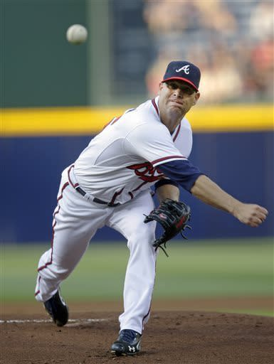 Atlanta Braves starting pitcher Tim Hudson works in the first inning of the Braves' baseball game against the Washington Nationals on Tuesday, April 30, 2013, in Atlanta. (AP Photo/John Bazemore)
