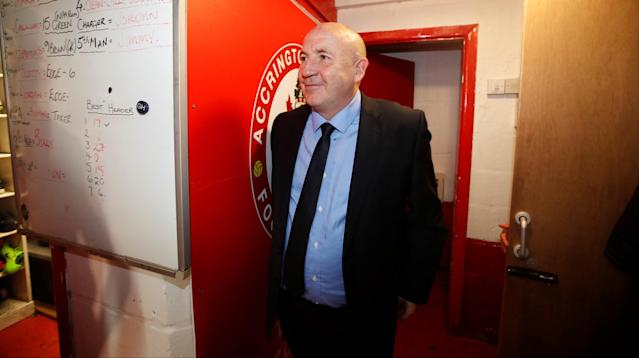 "Soccer Football - League Two - Accrington Stanley vs Yeovil Town - Wham Stadium, Accrington, Britain - April 17, 2018 Accrington Stanley manager John Coleman watches his players celebrate in the dressing room after winning promotion to League One Action Images/Carl Recine EDITORIAL USE ONLY. No use with unauthorized audio, video, data, fixture lists, club/league logos or ""live"" services. Online in-match use limited to 75 images, no video emulation. No use in betting, games or single club/league/player publications. Please contact your account representative for further details."