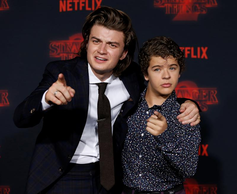 "Cast members Joe Keery (L) and Gaten Matarazzo pose at the premiere for the second season of the television series ""Stranger Things"" in Los Angeles, California, U.S., October 26, 2017. REUTERS/Mario Anzuoni"